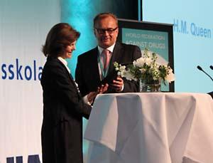 Foto av drottning Silvia och Sven-Olof Carlsson